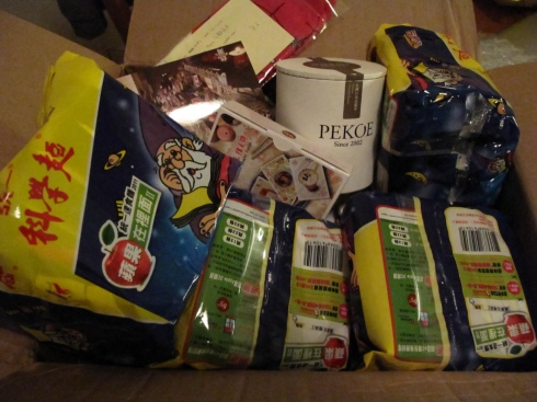 box from taiwan with dried noodles, socks, tea, cards